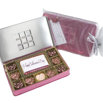 4 hearts with semisweet raspberry truffle centers; 4 milk chocolate hearts with milk chocolate truffle centers; 1 white chocolate heart with a raspberry mousse truffle center; & a Happy Valentine′s Day bar